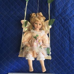 Fairy Porcelain Doll on Swing - Avon Collection